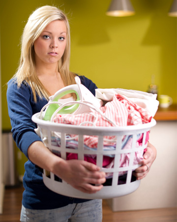 unhappy-woman-doing-laundry-vert.jpg